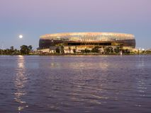 Moon rising over Perth Stadium, Swan River, Perth, Western Australia. Moon rising over Perth Optus Stadium, Swan River, Perth, Western Australia royalty free stock photos