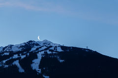 Moon Rising Over Whistler Blackcomb Royalty Free Stock Photography