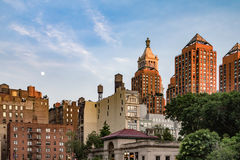 Moon Rising Above Union Square Park in New York City. Moon rising in the sky above Union Square Park at dusk in Manhattan, New York City NYC royalty free stock photos