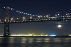 Moon Rising Under San Francisco Bay Bridge Stock Photos