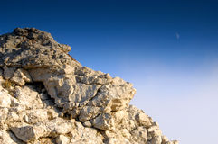 Moon and rock. Mysterious rock with a view of moon Royalty Free Stock Image