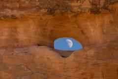 Moon through rock window Stock Photos
