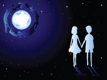 Moon and romantic couples. Romantic couple. Love the boy and girl.Walking in the moonlight Stock Images