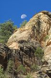 Moon and Sandstone cliff Stock Image