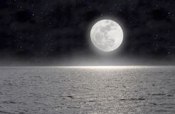 The moon on the sea Stock Photos