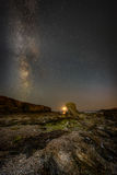 Moon Set with Milky Way over Porth Y Post. Royalty Free Stock Image