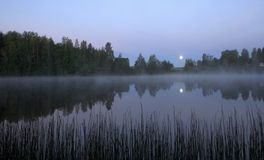 Moon set and morning mist Royalty Free Stock Photo