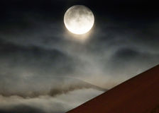 Moon sets over mountains in norway Royalty Free Stock Photo
