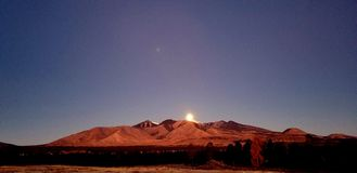 Moon setting behind the San Francisco Francisco stock photos