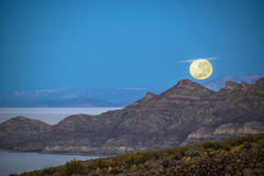 Moon Setting in Bolivia. Over the Uyuni Salt Flats Stock Photo