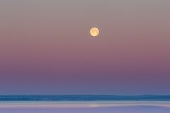 Moon setting over Gdanska Bay in Poland Stock Image