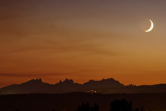 Moon setting over Montserrat. Catalonia, Spain Royalty Free Stock Image