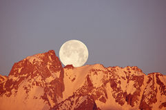 Moon Setting Over Mountain Stock Photography