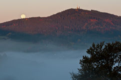 Moon setting over the mountain hill Royalty Free Stock Photo