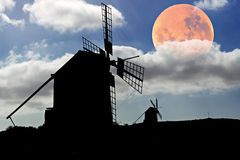 Moon setting over Spanish Windmills Royalty Free Stock Image