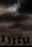 Moon and shadows. Silhouettes of people against the night sky Royalty Free Stock Photos