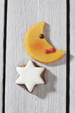 Moon shaped cookie and cinnamon star close up elevated view on wooden background Stock Images