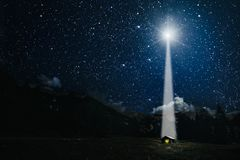 moon shines over the manger of christmas of Jesus Christ.