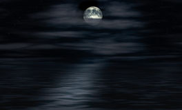 Moon shines over water Stock Photo