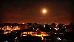 Moon. Shining moon in small city Royalty Free Stock Photos
