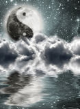 Moon with a sign of yin and yang. In the clouds Stock Images