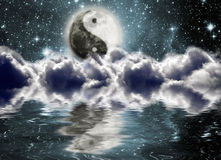 Moon with a sign of yin and yang. In the clouds Royalty Free Stock Photography