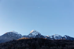 Moon in the sky above the peaks Stock Images