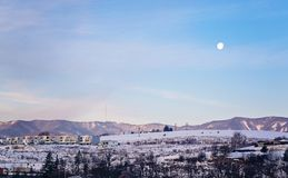 Moon on the sky early in the morning in winter royalty free stock photos