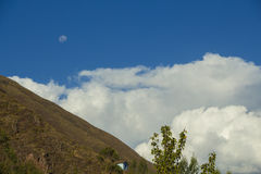 The moon in the sky. The moon looks more beautiful with the mountain and the blue sky stock photos
