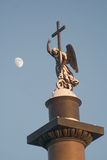 Moon and snow-covered angel. Angel on the top of Alexander Column on the Palace Square in Saint-Petersburg Royalty Free Stock Photo
