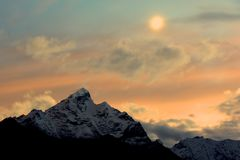 Moon and snow mountain. In Tibet Royalty Free Stock Image