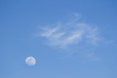 Moon and soft clouds in evening sky Stock Photography