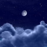 Moon in space or night sky through clouds Royalty Free Stock Image