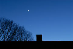 Moon, star, chimney and tree Stock Photos