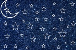 Moon and stars on blue glitter background Royalty Free Stock Photography