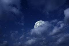 Moon and stars in cloudy sky Stock Photos