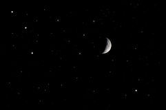 The moon at the night sky. The moon and the stars at the night sky Royalty Free Stock Image