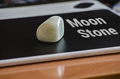 Moon stone tablet. The moonstone receives this name because it has always been considered to capture the properties of the moon. Although it is also known as stock photos