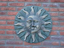 Moon and sun. Garden ornament moon and sun in one royalty free stock photography