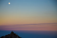 Moon and sunset landscape at the top of the Etna Stock Photography
