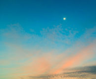 Moon on the sunset sky Royalty Free Stock Images
