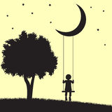 Moon swings. Child on swings hanging from the moon and tree silhouettes Stock Photos