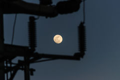 Moon Through The Transmission Tower. Moon on the night sky through the transmission tower stock photos