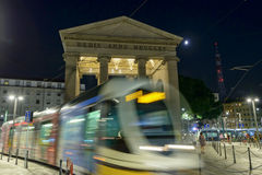 Moon and trolley car at Porta Ticinese Arch, Milan, Italy Royalty Free Stock Photos