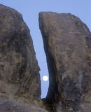 The Moon Between Two Rocks Stock Images