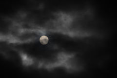Moon under clouds Royalty Free Stock Photo