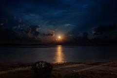 Moon under ocean on the sky with star stock photography