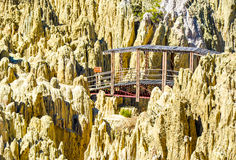 The Moon Valley, La Paz, Bolivia. Remains of mountains that have been eroded by weather and a bridge Royalty Free Stock Photos