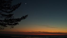 Moon and Venus observing after sunset stock photography
