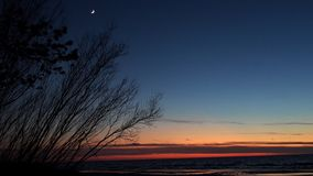 Moon and Venus observing after sunset royalty free stock photography